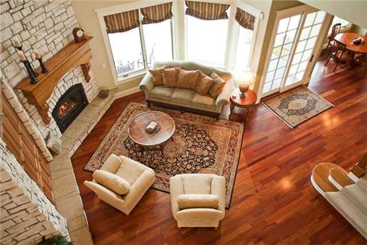 Aerial view of Great Room with fireplace and large windows