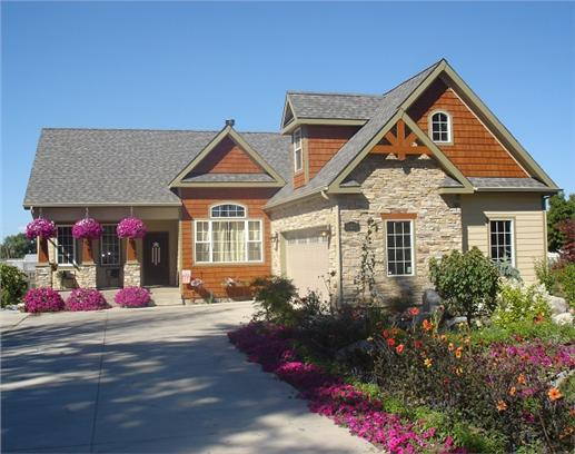 3 bedroom Craftsman L-shaped home with colorful flower gardens