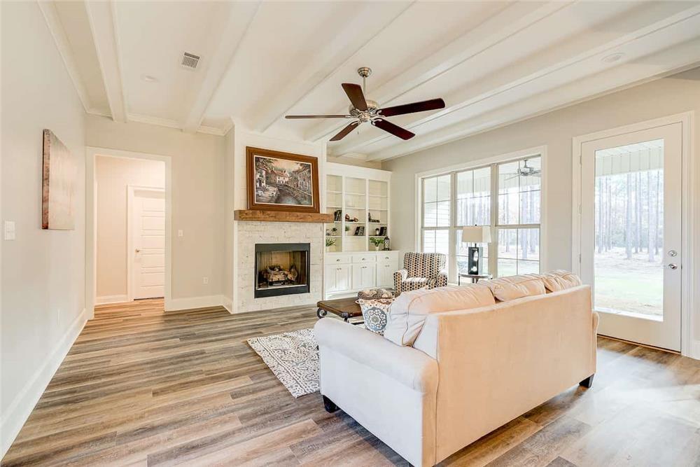 Family room with wood-look flooring in open-floor-plan home