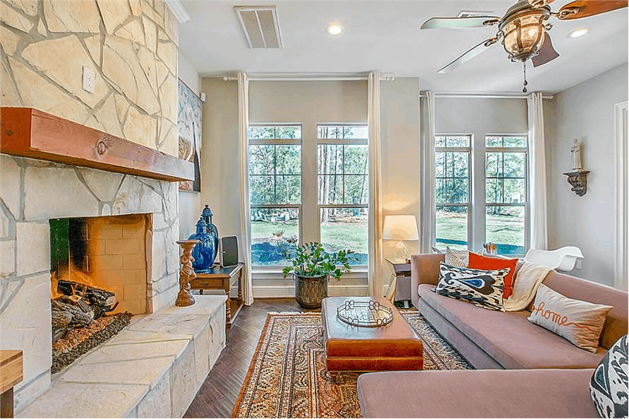 Hearth room in Country style home decorated in warm earth-tone colors