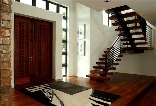 Entry to 2-story modern Florida-style house, seen from inside
