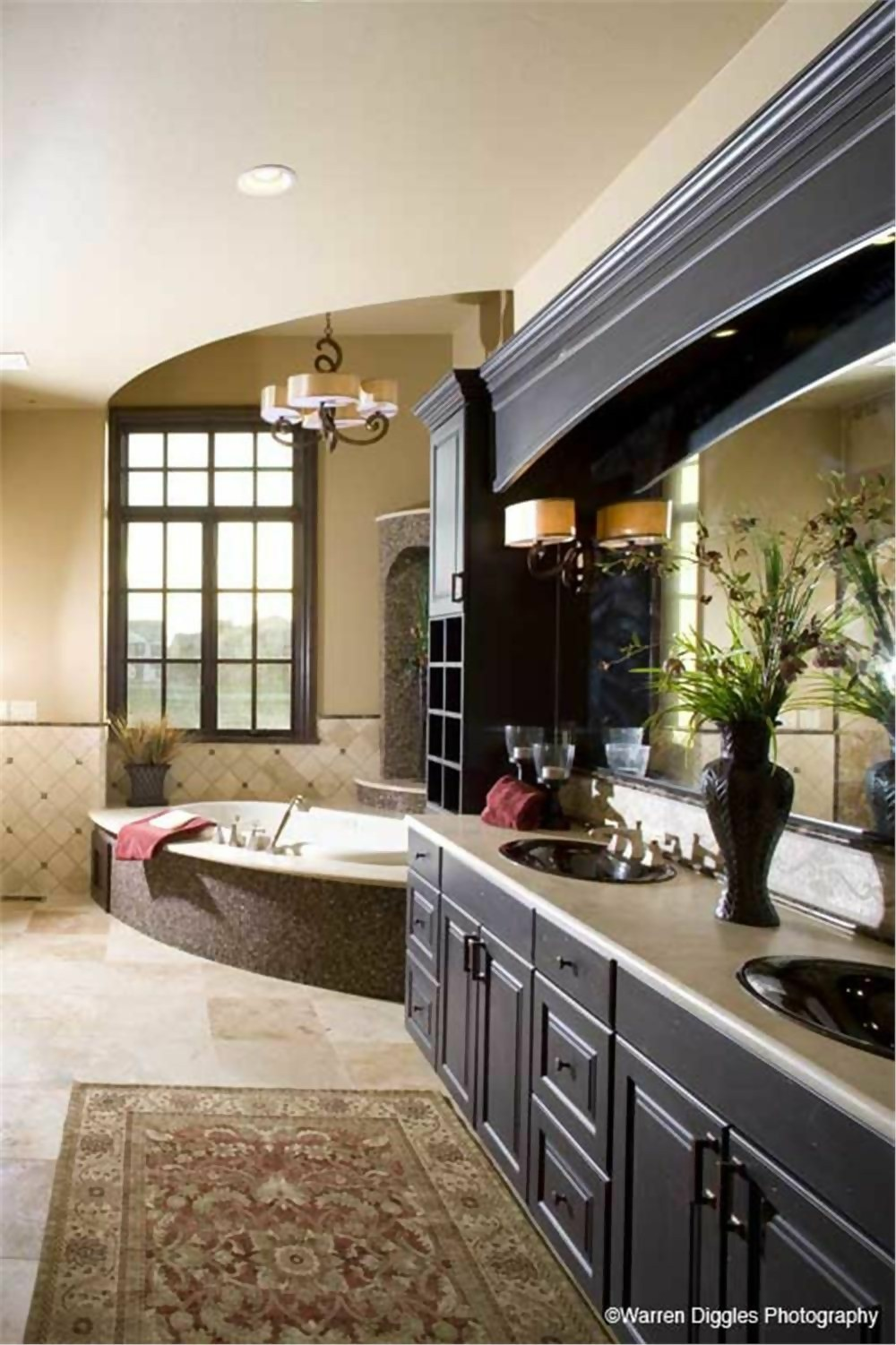 Luxurious master bathroom with dual vanities that appears in Tuscan style plan #161-1041