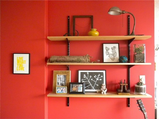 Bright red wall with shelves
