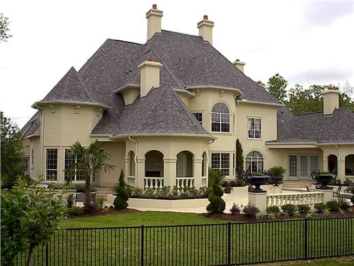 Rear view of a luxurious European style plan with pergola and lanai