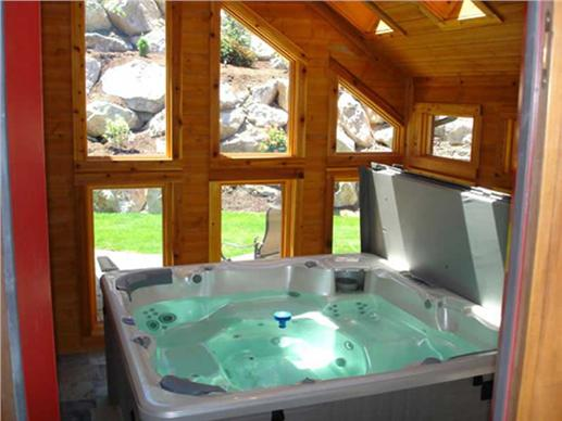 The hot tub and spa room - no Mountain style house is complete without one!