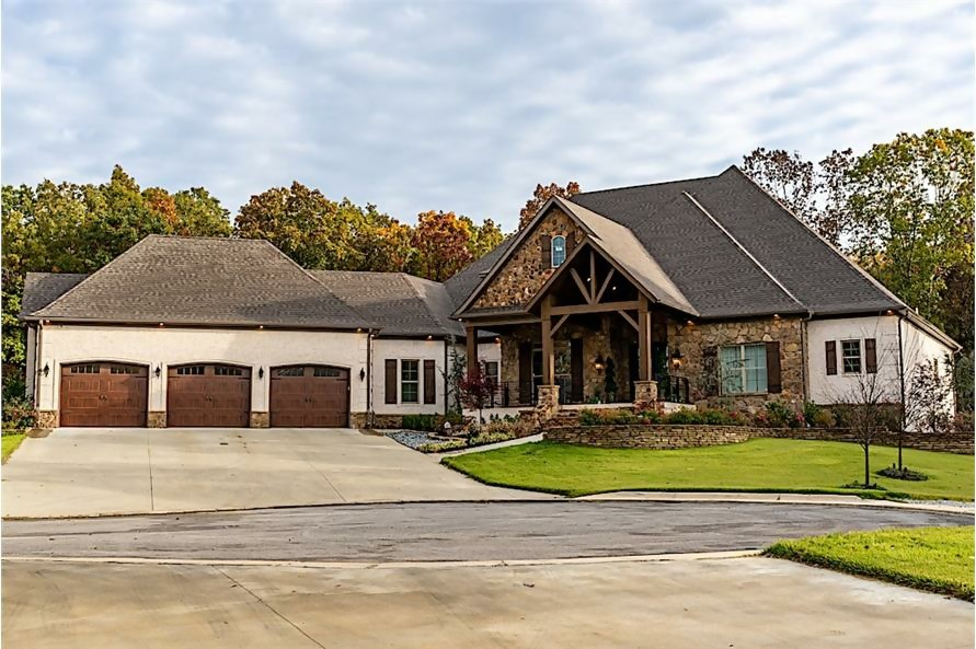 Transitional Ranch home with very steep hip roof that gives 2-story appearance