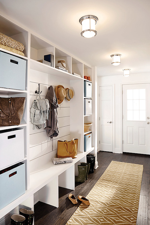 Mudroom entry with shelves, cubbies, and benches