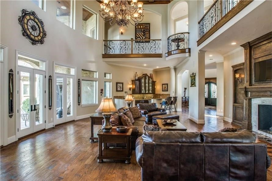 Elegant two-story foyer featuring a stunning chandelier