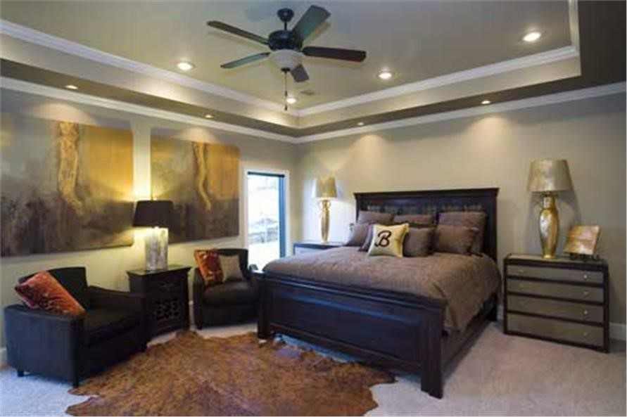 Master bedroom with dramatic 10-foot-tall ceiling in the boxed tray style