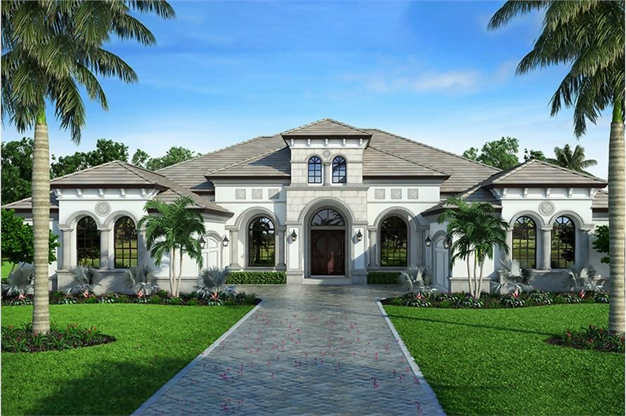Light gray stucco Mediterranean style home with its arched entryway and windows