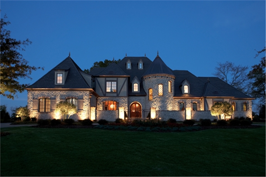 3-story French Country chateau style home with turret