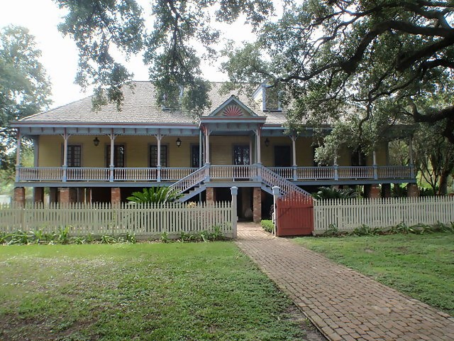 Acadian style Laura Plantation with its signature rectangular shape, fairly steep hip roof, and raised foundation