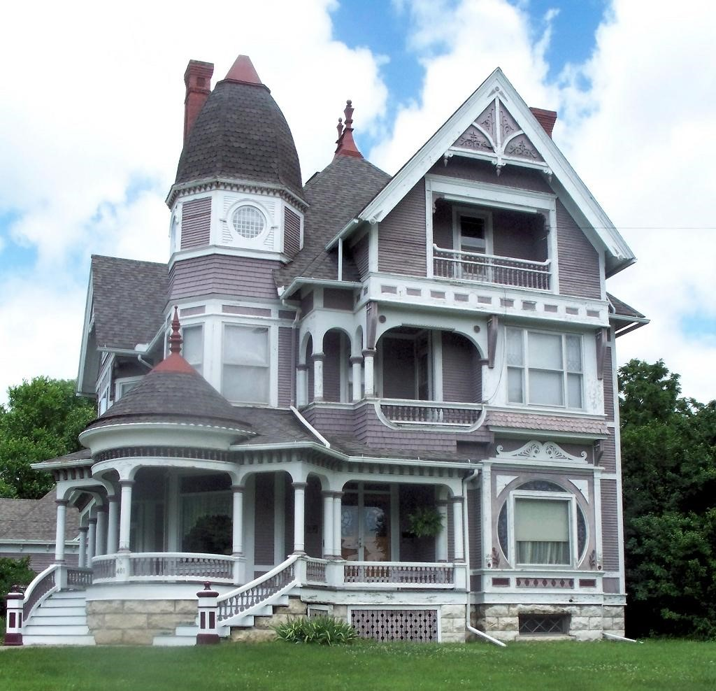 Impressive Queen Anne style home with fanciful trimwork and multiple roof treatments
