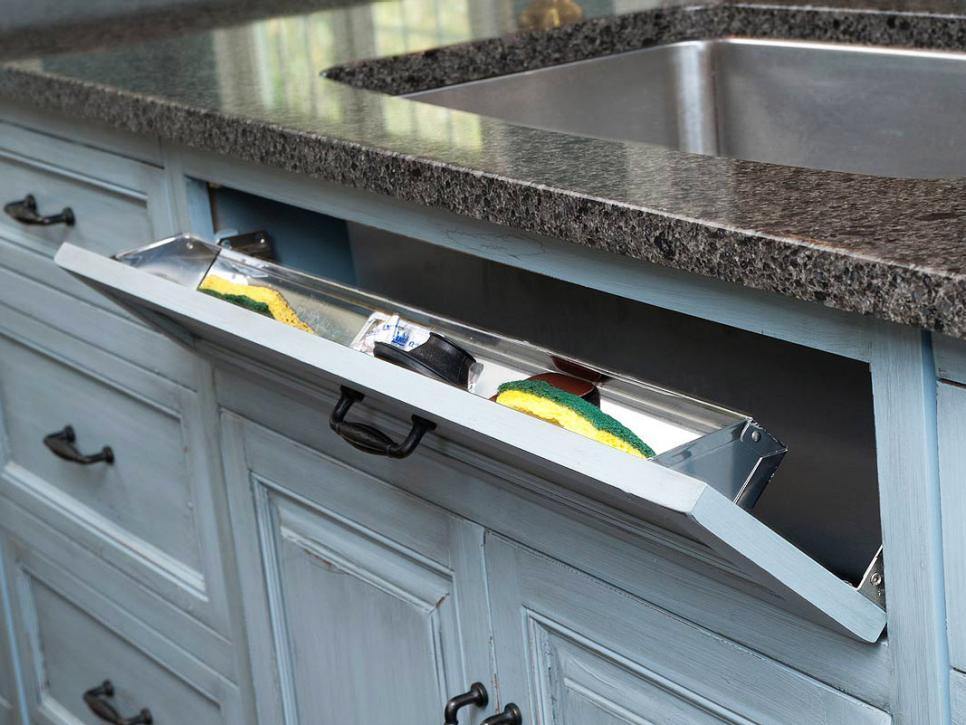 Flip-down storage in front of kitchen sink