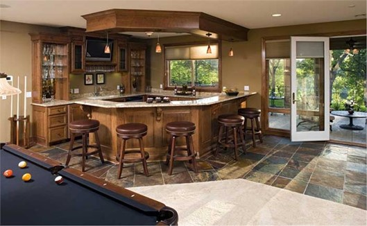 Walkout basement interior with large wet bar and socializing area
