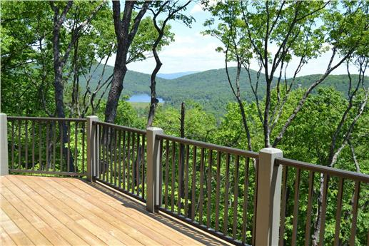 Gorgeous view of mountains and lake from the deck of this mountain-style home