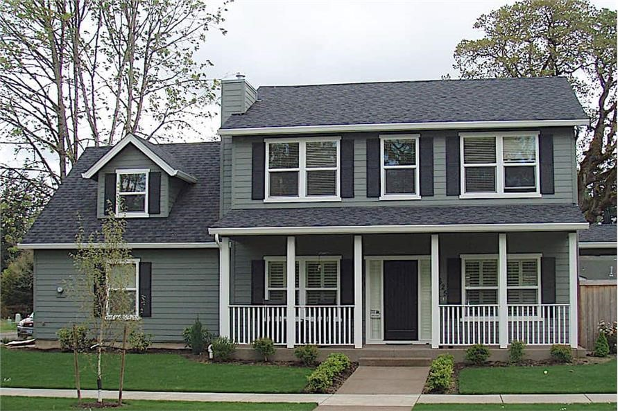 Simple Colonial home with gray siding and black window shutters