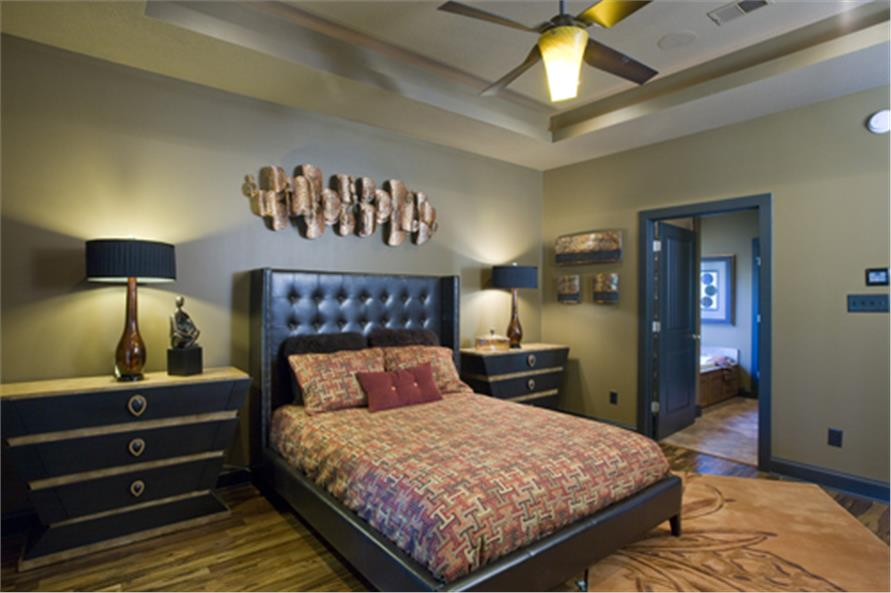 Master bedroom in a 3-bedroom, 2-bath Tuscan-style home