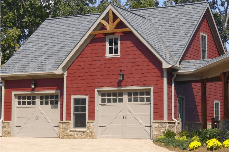 Red barn-like garage with an apartment on the second story