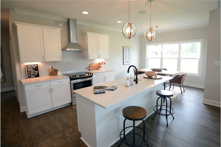 Attractive, roomy eat-in kitchen with center island and well-lit breakfast nook