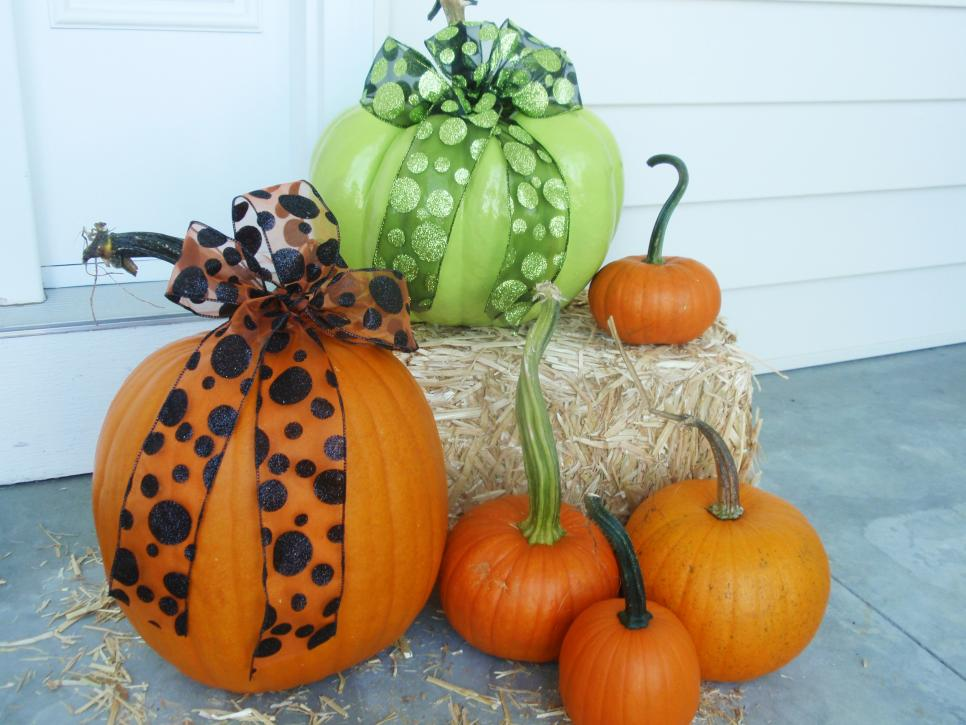 Pumpkins and hay on a front porch