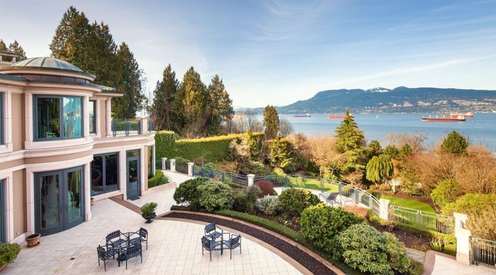Patio with unobstructed view of the Vancouvers English Bay and North Shore Mountains