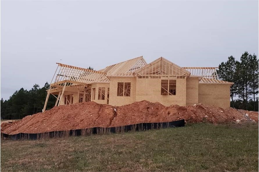 3,696-square-foot home under construction with wall sheathed but not roof