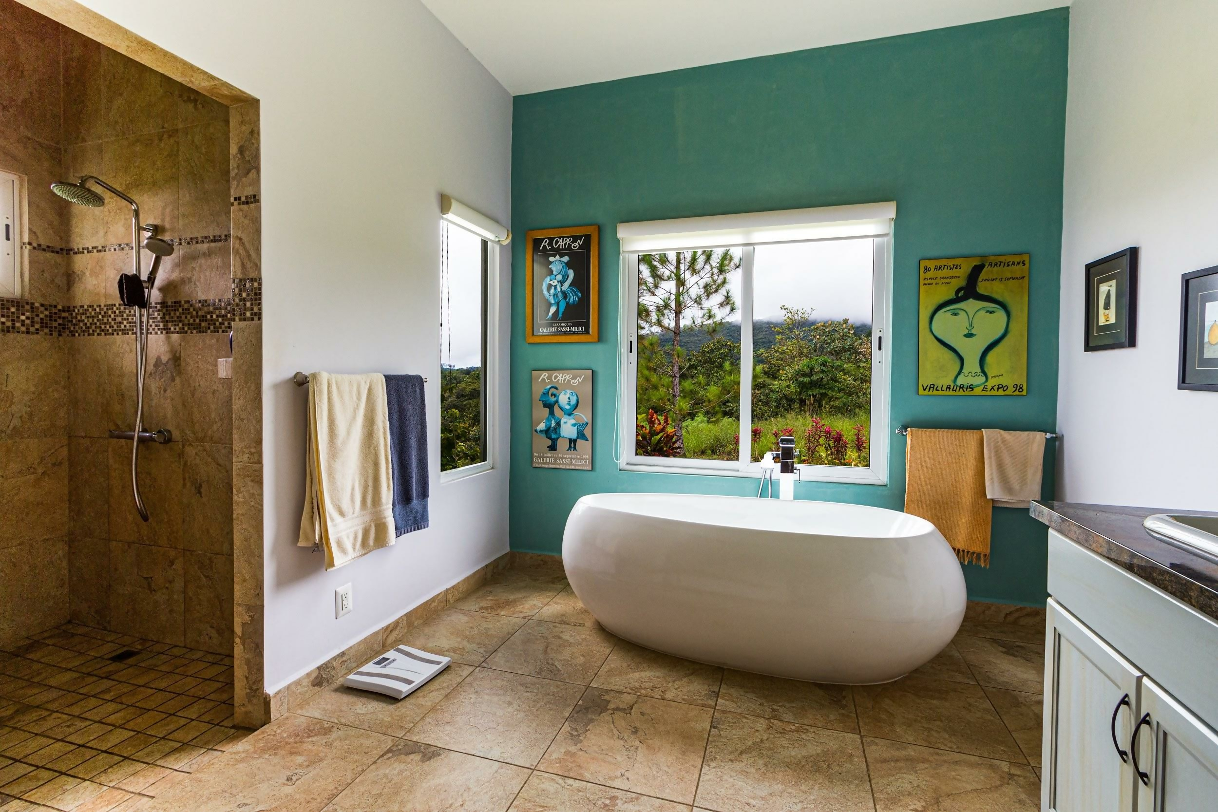 Bathroom with standalone bathtub in front of bright-green accent wall