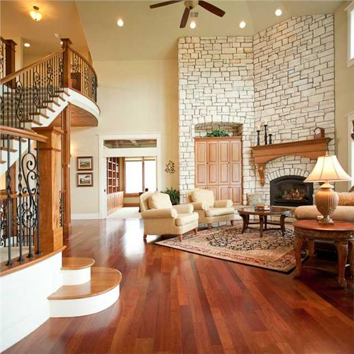 Lovey great room with fireplace and high ceilings.