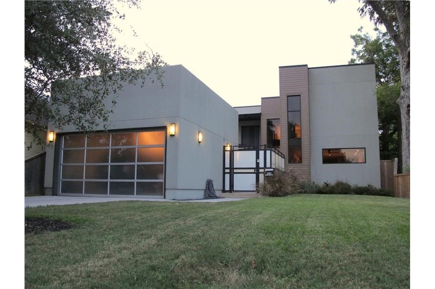 2-story, 4-bedroom modern home with Art Deco features like geometric shape and clean wall surfaces