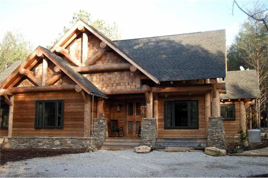 Log cabin with cedar shingle and clapboard siding
