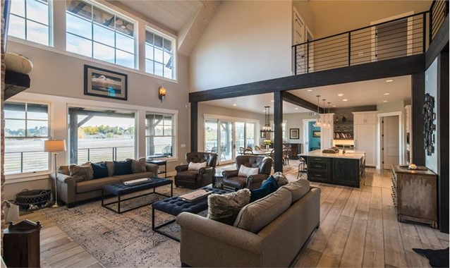 Great Room highlighted by lots of large glass windows and sliding doors