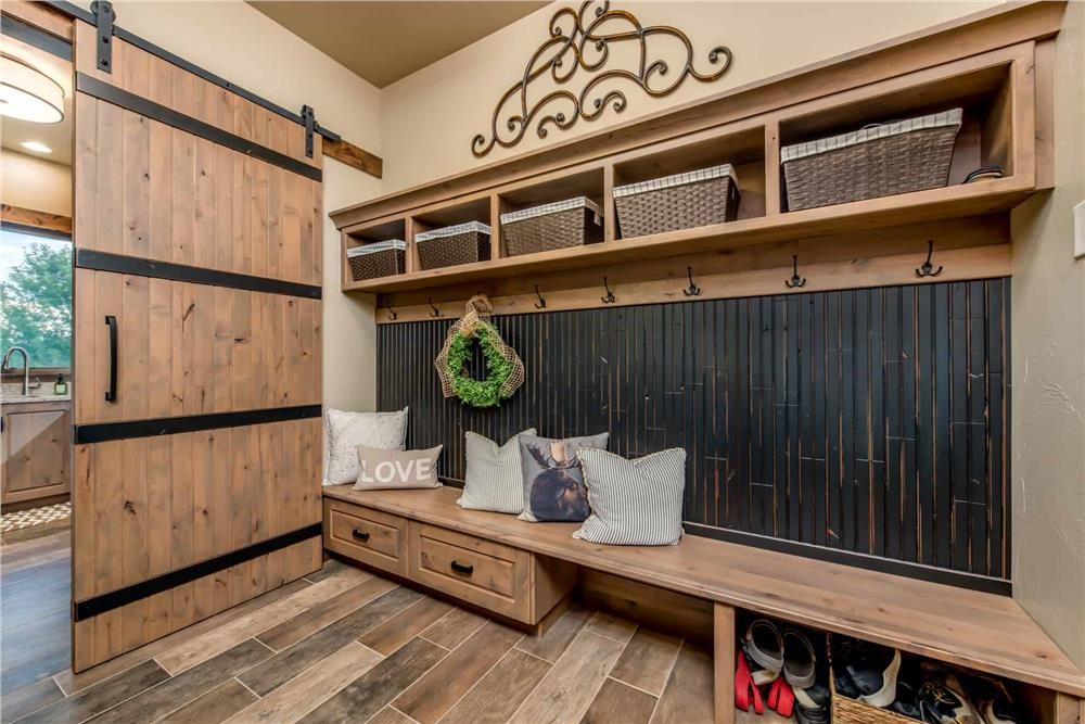 Mud room with bench, cubbies, hooks, and a large storage drawer