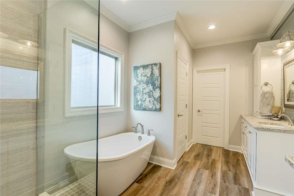 Master bathroom with wood-look flooring