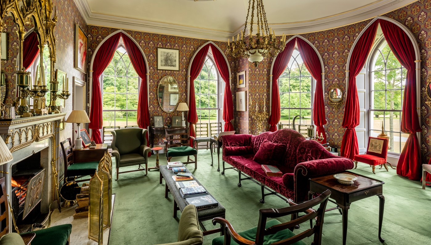 Lliving room inside Luggala Lodge with arched glass windows