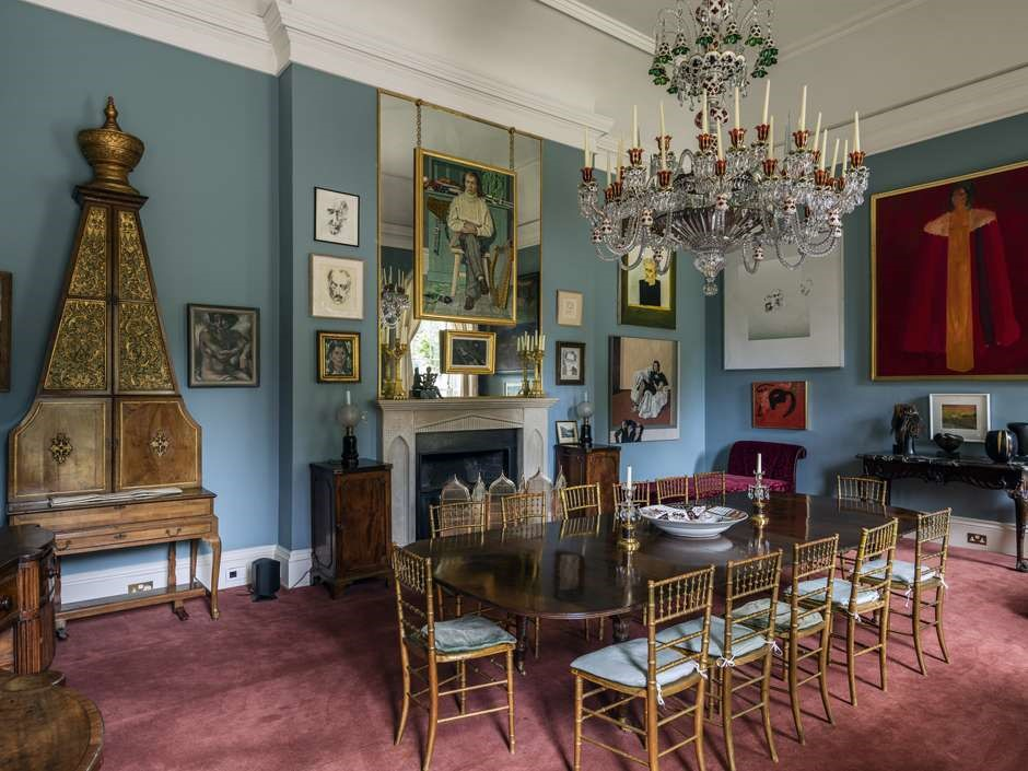 Ornately-designed wood secretary, chandeliers, and fixtures in Luggala Lodge