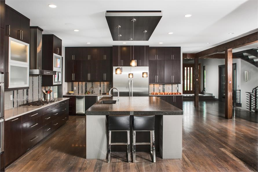 Modern kitchen with recessed ambient, under-cabinet, and pendant lighting