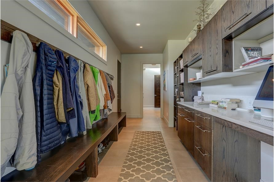 Mud room with benches, storage, and hooks for coats and outerwear