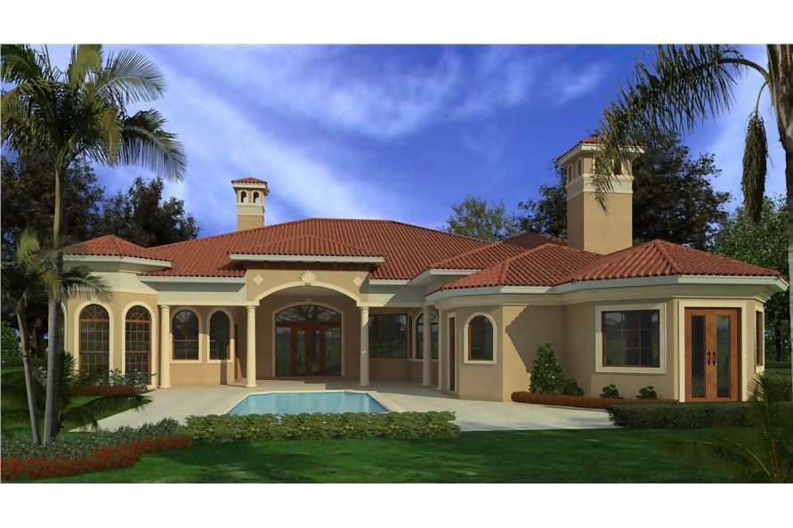 Spanish style home with chimneys that resemble California Mission bell towers