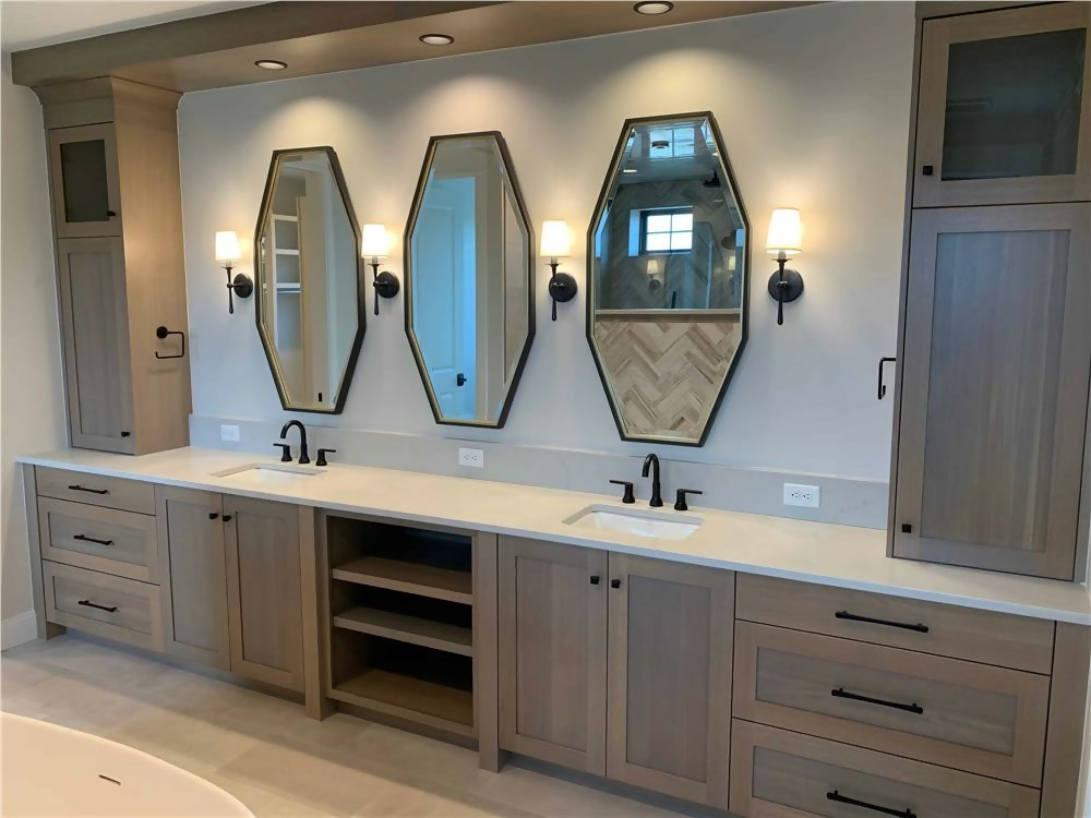 Split vanity with three mirrors and sidelights in a contemporary bathroom