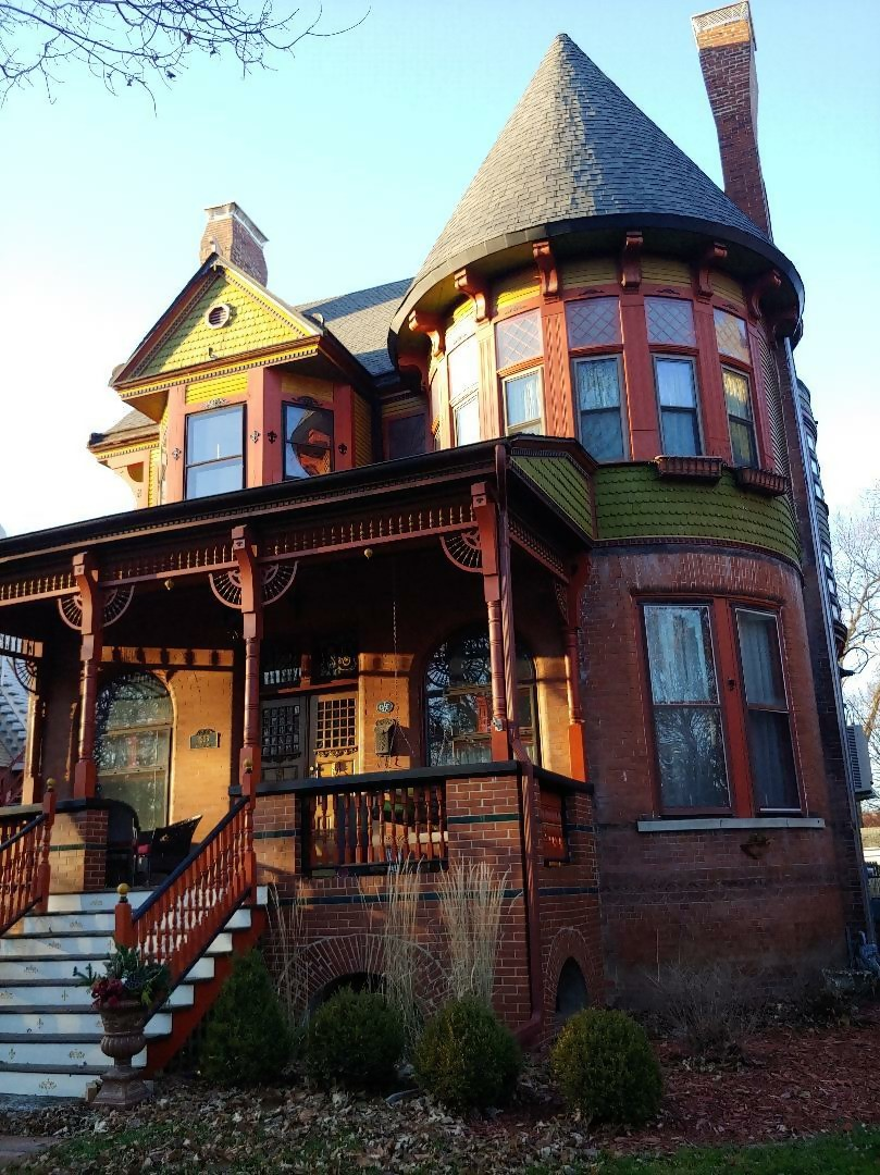 2-story Queen Anne Revival home with  steep roof pitch and traditional asymmetrical facade