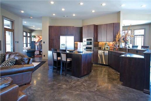 Open floor plan showing dark wood cabinets in kitchen