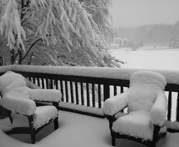 Deck is winter with snow on it