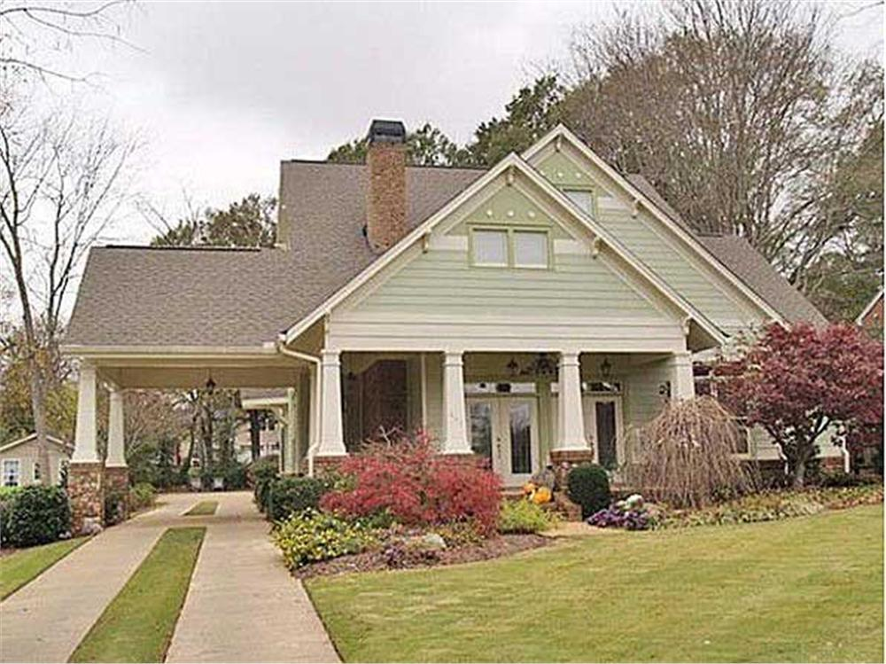 1-story, 3-bedroom Country-style house with size-sequenced plantings in landscape