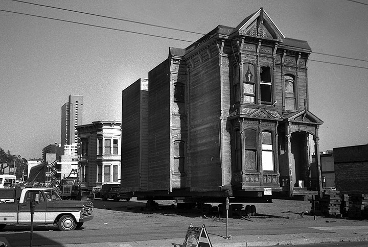 Victorian home being transported in '70s San Francisco