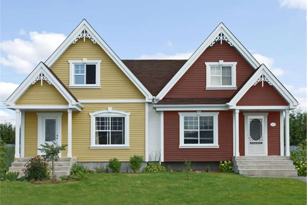 Duplex home with one unit painted golden yellow and one painted red
