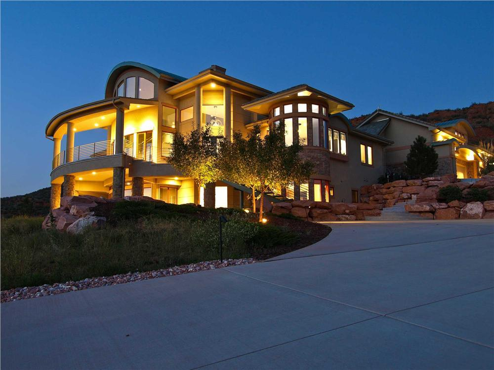 Mountainside view of House Plan #161-1000 at night