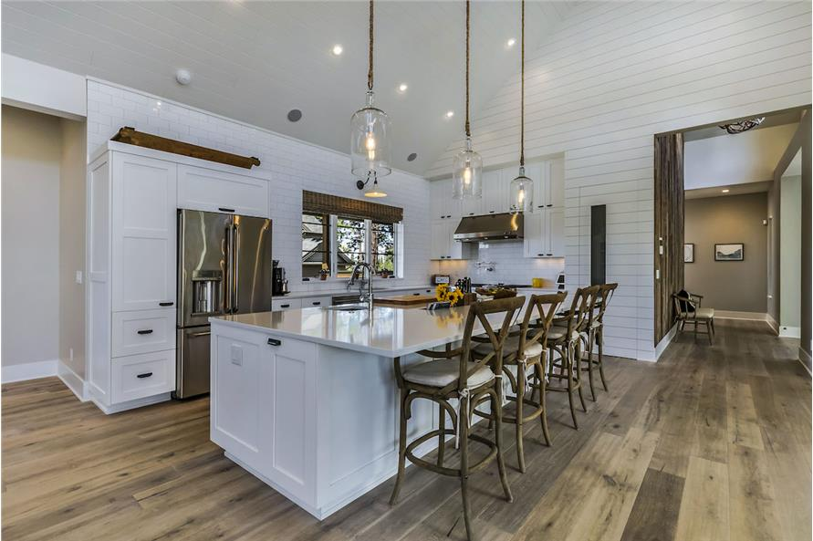 Kitchen with natural lighting, recessed ceiling lights, industrial-vibe pendants, lights under the cabinets