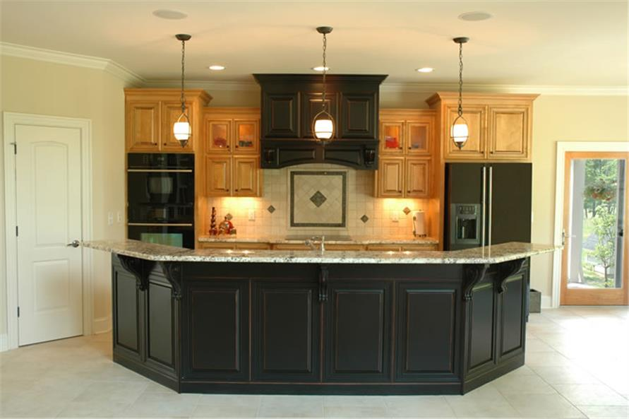 Kitchen with dark cabinets and island