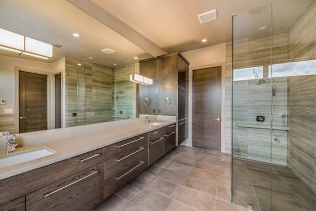 Large modern bathroom with recessed lighting and oversize mirror
